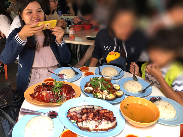 Thyda and Channey eating chicken rice